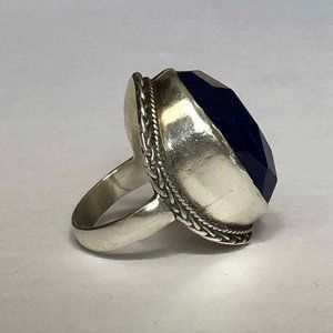 Silver statement ring with a blue sapphire stone